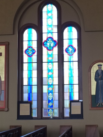 Sacraments in stain glassed windows